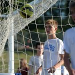 Junior Sam Thompson eyes the ball that he kicked to the top corner of the goal. Photo by Kaitlyn Stratman