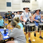 Seniors Deegan Poores and Ian Longan lead the drum line through the tables of the auxilary gym. This was their first performance of the school year. Photo by Annie Lomshek