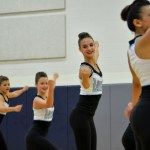 Freshman Pacey Saltzman dances alongside Captain and sophmore Maggie Mulligan, freshman Ellie Brown, and freshman Caroline Seitz for her first year on Junior Varsity Dance Team. Photo by Katherine Odell