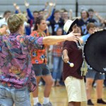 Senior Brayten Bowers teaches the school the last new chant, with the help of junior Sid Choudry from drumline. Photo by Izzy Zanone