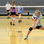 Sophomore Lily Taylor prepares to hit the ball. Photo by Ellen Swanson