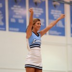 Senior and Varsity Cheerleader, Mallory Gray, performs a stunt during the freshman pep rally. Photo by Maddie Smiley