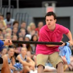 Sophomore Jack Melvin helps out the football team during the soccer against football tug-of-war game. Photo by Maddie Smiley