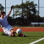 Junior Nick Gasperi slides to save the ball from going in the goal. Photo by Sophie Storbeck