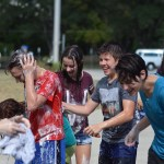 A group of freshmen splash each other with soap and water at the Theater Car Wash. Photo by Katherine Odell