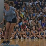 The Fall sports; girl's Tennis, girl's Volleyball, girl's Golf and Cross Country play a relay game during the first assembly of the year. Kaitlyn Stratman, Senior who is a JV Volleyball player, represents her team. Photo by Morgan Plunkett