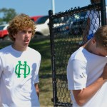 On the last day of tryouts for boys Soccer, freshman, Peter Kohring(left) is rushing to a huddle. After going through their routine warm ups. Ready to run the pacers and play some scrimmages! Photo by Morgan Plunkett