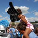 A little Lancer holds a Lancer fan finger above the crowd. Photo by Caroline Mills