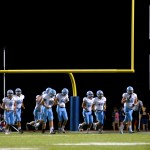 The Lancers walk back to the sideline after warming up during halftime. Photo by Caroline Mills
