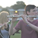 "Sophomore Ben Colvin plays along to ""Prince Ali"" for marching band practice in zero hours. Photo by Morgan Plunkett"