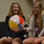 At the student council retreat, sophomores Olivia Caponecchi and Hannah Phillips catch the ball, in a fun game of passing a ball around ina circle. Photo by Morgan Plunkett