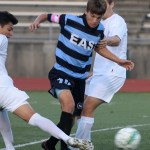 Captian, Senior Oliver Bihuniak, takes on two defenders as he dribbles up the field. Photo by Kaitlyn Stratman