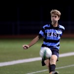 Sophomore Charley Colby passes to the ball down, helping East advance to the goal. Photo by Kaitlyn Stratman