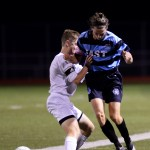 A South player pushes senior Clayton Phillips back while they race for the ball. Photo by Kaitlyn Stratman