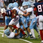 Senior David Goldstein tackles the Olathe North runningback on the 20 yard line. Photo by Haley Bell