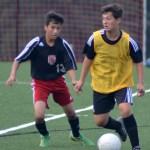 Freshman Daniel Adel rushes around the defender advancing towards the goal. Photo by Izzy Zanone