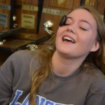 Junior Gibson Hoefgen tries to move the Oreo down her face. Photo by Izzy Zanone