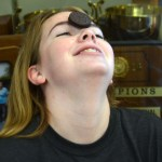 Sophomore Elise Baker tries to get a cookie into her mouth without using her hands. Photo by Izzy Zanone