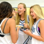 Juniors Hannah McPhail, Anna McClelland, and Alyssa Vuillimen laugh as they take turns feeding each other pancakes. Photo by Ellie Thoma