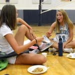 Seniors Porter Carroll and Libby Legard joke around as they eat their pancakes. Photo by Ellie Thoma