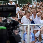 Seniors  Christian Hense and Porter Carroll point to the news camera that is filming the crowd. Photo by Ellie Thoma