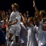 """Students from the student section and the varsity soccer team celebrate together on the field with a win. Sophomore Charley Colby says, """"The best moment of the game was the mosh pit on the field with the team. We worked so hard that game and fought back to get a great win against a really good opponent."""" Photo by Audrey Kesler"""