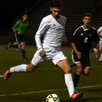 Senior Greyson Rapp looks to chip the ball forward to his fellow strikers.  Photo by Audrey Kesler