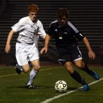 Junior Tommy Nelson looks to steal the ball and keep the offensive attack alive. Photo by Audrey Kesler