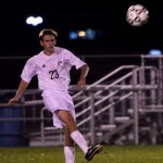 Junior Jack Pritchard sends the ball to a teammate down the field. Photo by Kaitlyn Stratman
