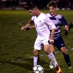 Senior Grayson Rapp keeps the ball in front of his opponent so he can't gain possession. Photo by Kaitlyn Stratman