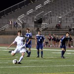 Senior Oliver Bihuniak kicks and scores a goal against Blue Valley North. Photo by Katherine Odell