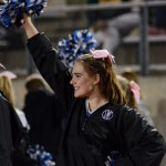 Freshman Kimball Gogel cheers on the football players from the sidelines. Photo by Ellen Swanson