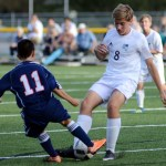 Sophomore Harrison Gloe competes for possession of the ball. Photo by Ellen Swanson