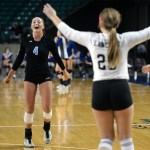 Senior Ally Offerdahl cheers with her teammates after the last point was scored against Manhattan, putting varsity volleyball third in the state. Photo by Kaitlyn Stratman