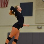 Junior Victoria Yedo prepares to serve the ball to her opposing players. Photo by Libby Wilson