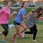 Juniors Ava Meng, Emma Renwick, and Scheele Prust practice playing defense. Photo by Libby Wilson