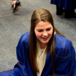 """Junior Ellie Willis talks with her friends before the Choraliers turn to take the stage. """"My favorite thing about choir is listening to how the choir blends as a whole to make such great music,"""" Willis says. Photo by Maddie Smiley"""