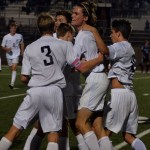 The team jumps and hugs after scoring the final goal. Photo by Izzy Zanone