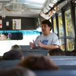 Art teacher Mr. Finkleston describes the rules of the library to the students on the bus. Photo by Diana Percy