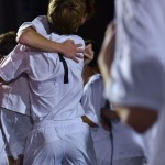 Two varsity soccer players hug with excitement of winning their quarter-finals game for state. Photo by Morgan Plunkett