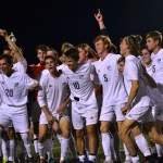 The team breaks from their picture to cheer in excitement about their win. Photo by Morgan Plunkett