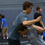 Junior Will Knutson tackles junior Austin Wilson during their wrestling tryouts. Photo by Morgan Plunkett