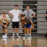 The boys trying out for basketball line up to begin running sprints. Photo by Katherine Odell