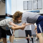 Senior William Schmidt battles with his teammate as they practice at their second day of tryouts for wrestling. Photo by Katherine Odell