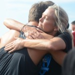 Senior Will Clough hugs Coach Tricia Beaham after final race. Photo by Carson Holtgraves