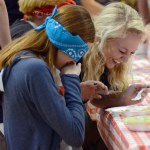 Seniors Emily Kohring and Ellie Mitchell laugh after Kohring is fed canned food while blindfolded. Photo by Ellen Swanson