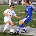 Junior Max Madday fights his opponent for possession near the sideline. Photo by Kaitlyn Stratman
