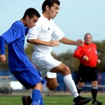 Junior Cooper McCullough focuses on the ball while taking the lead over his opponent. Photo by Kaitlyn Stratman