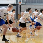 The boys run timed sprints while dribbling, trying to make it down and back nine times.  Photo by Kaitlyn Stratman