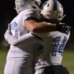 Senior Nigil Houston hugs teammate after he scored a touchdown. Photo by Izzy Zanone